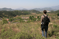 A hiker looks out over the rolling hills of Miyun District in rural Beijing