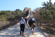 Hikers on the way up to Great Wall tower on the Huanghuacheng Great Wall