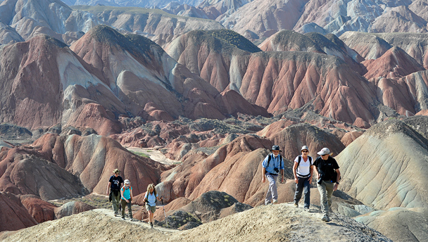 Hikers deep in the hills of the Zhangye Danxia Landform