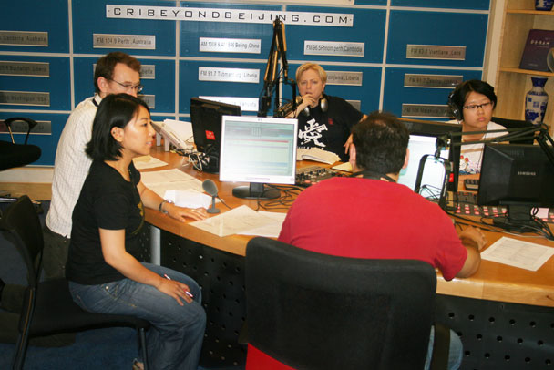Huijie with the radio hosts and producer - Huijie interviewed on China Radio International