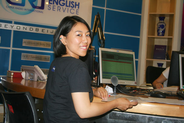 Huijie at the talk show desk - Huijie interviewed on China Radio International