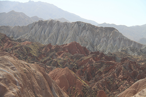 In the distance, pointed white hills, Badain Jaran Desert and Zhangye Danxia Landform, 2013/09