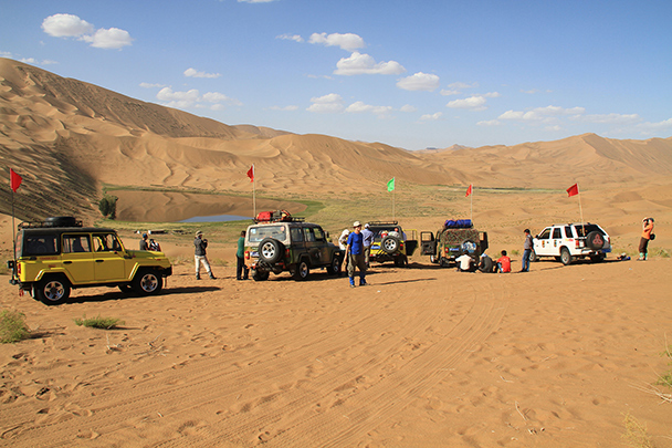 Our jeeps drove us into the desert, passing this lake, Badain Jaran Desert and Zhangye Danxia Landform, 2013/09