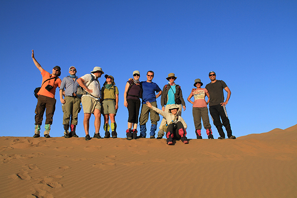Hikers in the desert, Badain Jaran Desert and Zhangye Danxia Landform, 2013/09