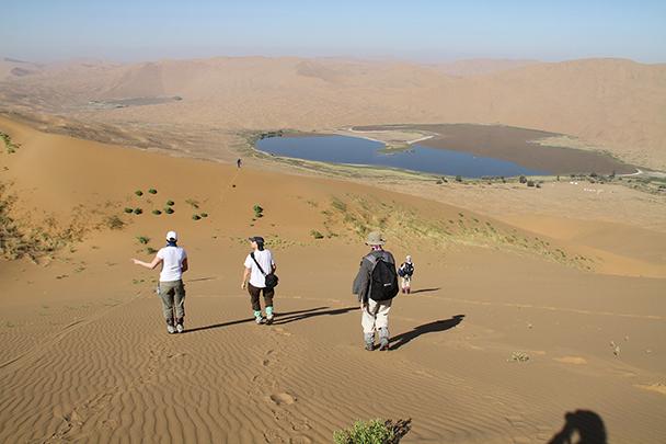 Walking down the sand dunes, Badain Jaran Desert and Zhangye Danxia Landform, 2013/09