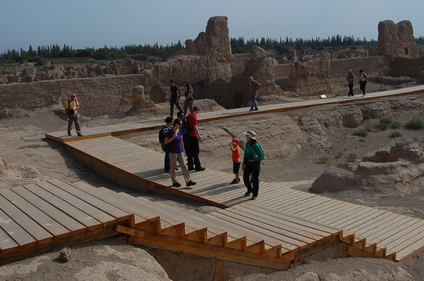 A boardwalk leads through the ruins of a temple in the Jiaohe Ancient City., Beijing Hiker's Journey from the West, 2013/10