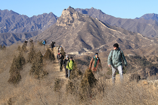 Hikers following a trail atop the Great Wall, with more Great Wall visible in the hills behind, Gubeikou Great Wall loop hike, 2013/12/21