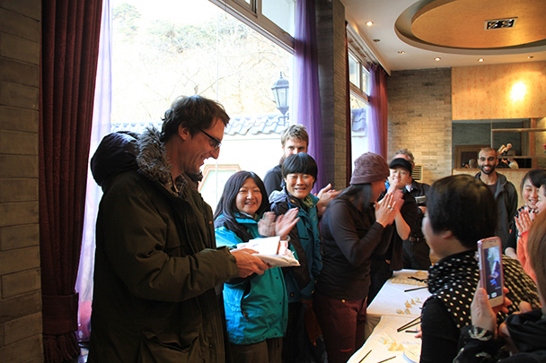 The winner of the 'Best Dumpling' award receives the grand pize – a T-shirt, a book, a hiking bag cover, and a voucher for 100 RMB - Jiankou to Mutianyu Great Wall, 2014/01/12