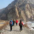Hikers on a gravel trail, White River ice hike, 2014/01/19