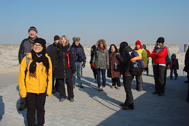 Hikers and local tourists enjoying the sun on the wall beside the temple - Yu County CNY 2014 Overnighters, Part 2