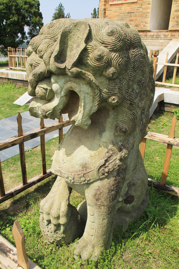 A stone lion outside the pagoda - Wuyuan County, Jiangxi Province, 2014/03