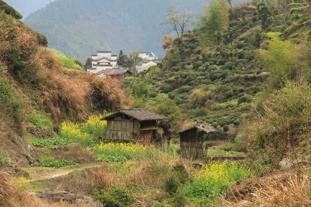 Huts beside the fields. It rains a lot in Wuyuan, so it's important to be able to shelter from the storm - Wuyuan County, Jiangxi Province, 2014/03