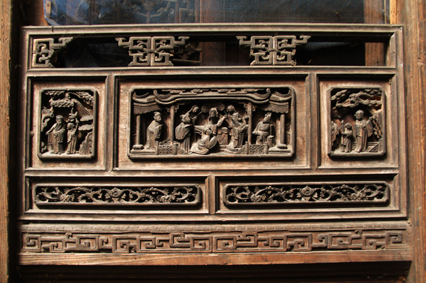 More of the specially carved woodwork, this one as part of a door frame - Wuyuan County, Jiangxi Province, 2014/03