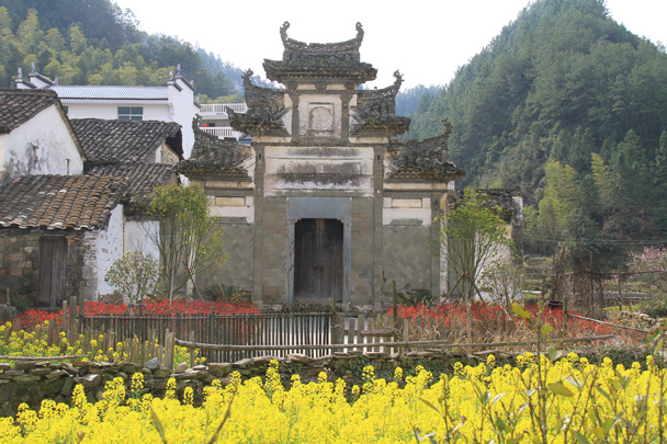 A big archway. This is the local architectural style, quite different than what we see in Beijing - Wuyuan County, Jiangxi Province, 2014/03
