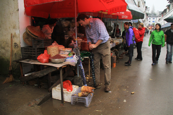 Seeing what's on sale at a local street market - Wuyuan County, Jiangxi Province, 2014/03