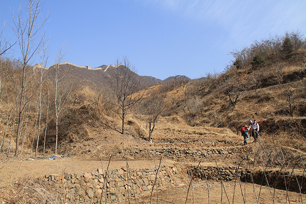 We followed a trail through fields up towards the Great Wall - Bricks in the Wall hike, 2014/03/15