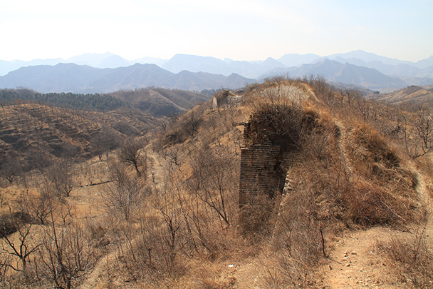 The base of a Great Wall tower blends into the dust and dirt - Bricks in the Wall hike, 2014/03/15