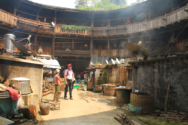An ancient building with modern additions in the communal courtyard - Hakka Tulou Clusters and Xiamen, Fujian Province, 2014/04
