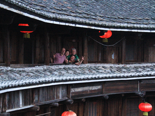 Friends on the upper balcony of the tulou building - Hakka Tulou Clusters and Xiamen, Fujian Province, 2014/04
