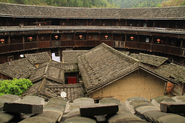 A view of the courtyard inside. This tulou has extra halls and rooms inside; some of the tulou buildings have an open courtyard - Hakka Tulou Clusters and Xiamen, Fujian Province, 2014/04