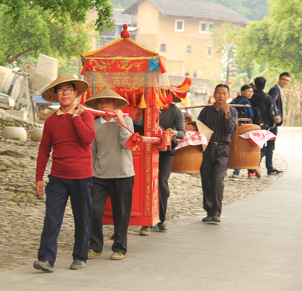A palanquin like this is typically part of a wedding ceremony - Hakka Tulou Clusters and Xiamen, Fujian Province, 2014/04