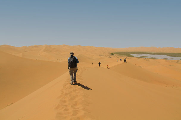 Hiking on the ridge of a huge dune, heading for the next lake - Alashan Desert, Inner Mongolia, 2014/05