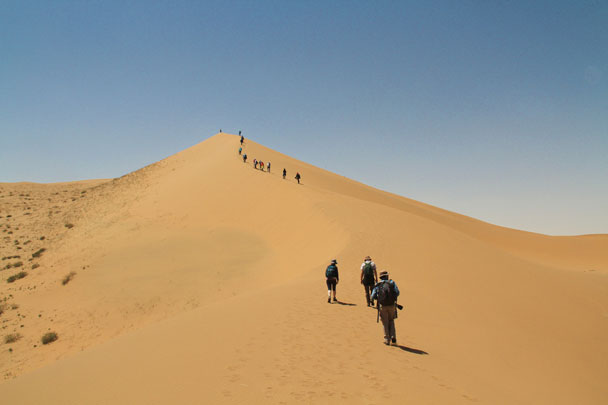 Following the footprints of other hikers to the top of a dune – a tough climb! - Alashan Desert, Inner Mongolia, 2014/05