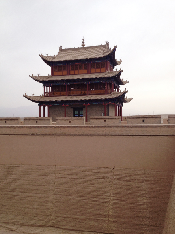One of the towers at the Jiayuguan Fortress, with the layers of rammed earth visible at the base of the wall - Zhangye Danxia Landform and Jiayuguan, Gansu Province, May 2014