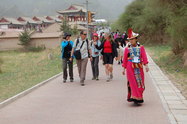 A colourfully-dressed local guide took us up to the Horsehoof Temple - Zhangye Danxia Landform and Jiayuguan, Gansu Province, May 2014