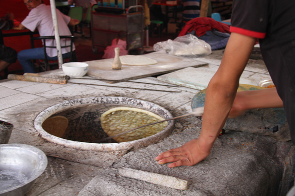 Here's how they cook the bread - Along the Silk Road from Korla to Kashgar, 2014/06