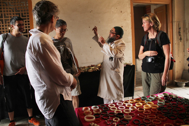 He had a strong sales pitch for the stone bracelets on the table - Along the Silk Road from Korla to Kashgar, 2014/06