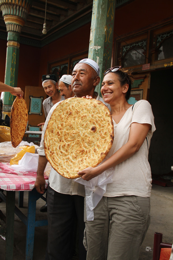 We had to get a photo with the man responsible for all this bread - Along the Silk Road from Korla to Kashgar, 2014/06