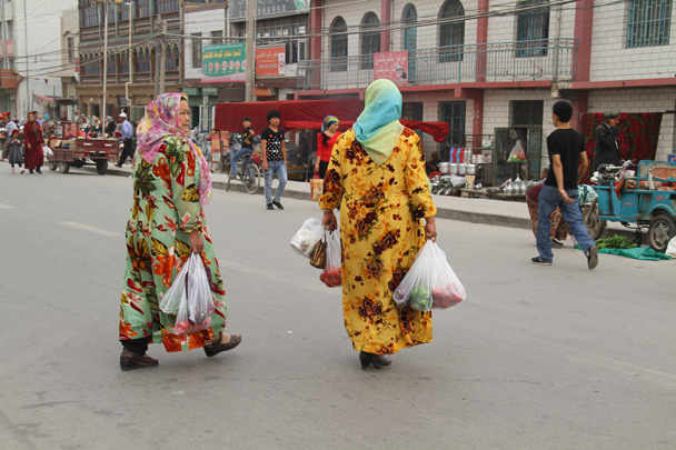 Colourful clothes for a spot of shopping - Along the Silk Road from Korla to Kashgar, 2014/06