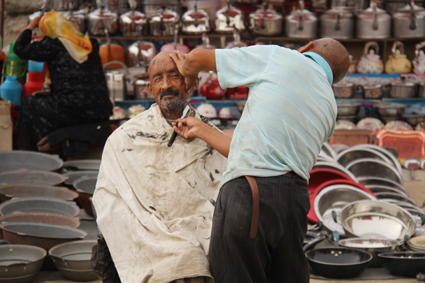 Outdoor barber in Kuqa - Along the Silk Road from Korla to Kashgar, 2014/06