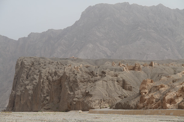 More ruined buildings on a cliff above the river - Along the Silk Road from Korla to Kashgar, 2014/06