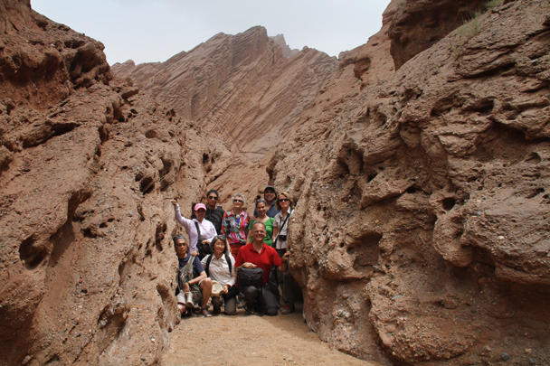 From when we visited the big canyon: just enough room to squeeze in for a group shot! - Along the Silk Road from Korla to Kashgar, 2014/06