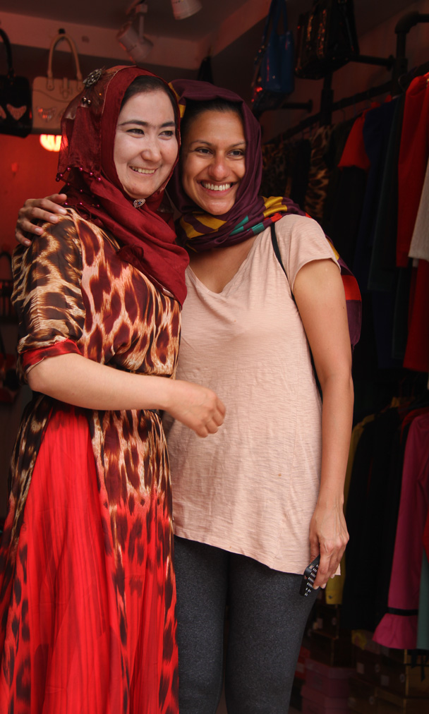 Happy salesperson and a happy customer - Along the Silk Road from Korla to Kashgar, 2014/06