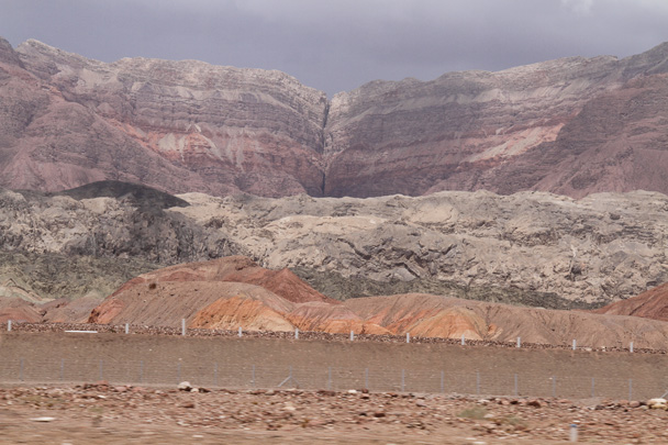 Coloured cliffs in the distance - Along the Silk Road from Korla to Kashgar, 2014/06