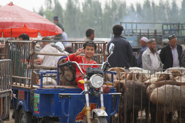 A young girl at the market - Along the Silk Road from Korla to Kashgar, 2014/06