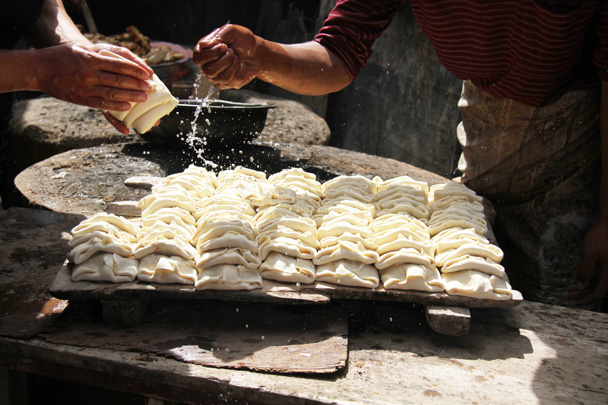 A kind of dumpling, being sprinkled with water before baking - Along the Silk Road from Korla to Kashgar, 2014/06