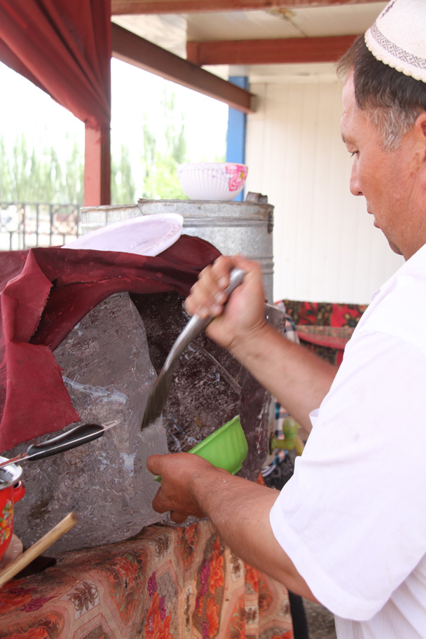 Chipping off ice for a yoghurt concoction - Along the Silk Road from Korla to Kashgar, 2014/06