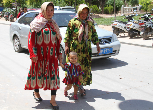 Colourful clothing on these ladies out for a stroll - Along the Silk Road from Korla to Kashgar, 2014/06