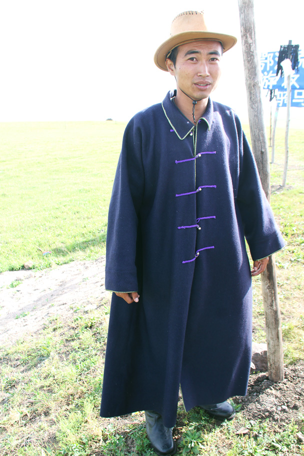 A local herdsman dressed in traditional costume - Hulunbuir Grasslands, Inner Mongolia, 2014/07