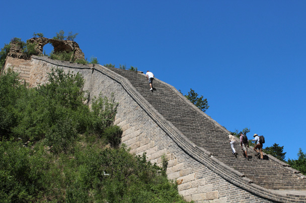 The steep stairs on this part of the Great Wall have been renovated. Past the tower at the top, the Great Wall here is in 'wild' condition - Zhuangdaokou Great Wall to the Walled Village, 2014/07/12