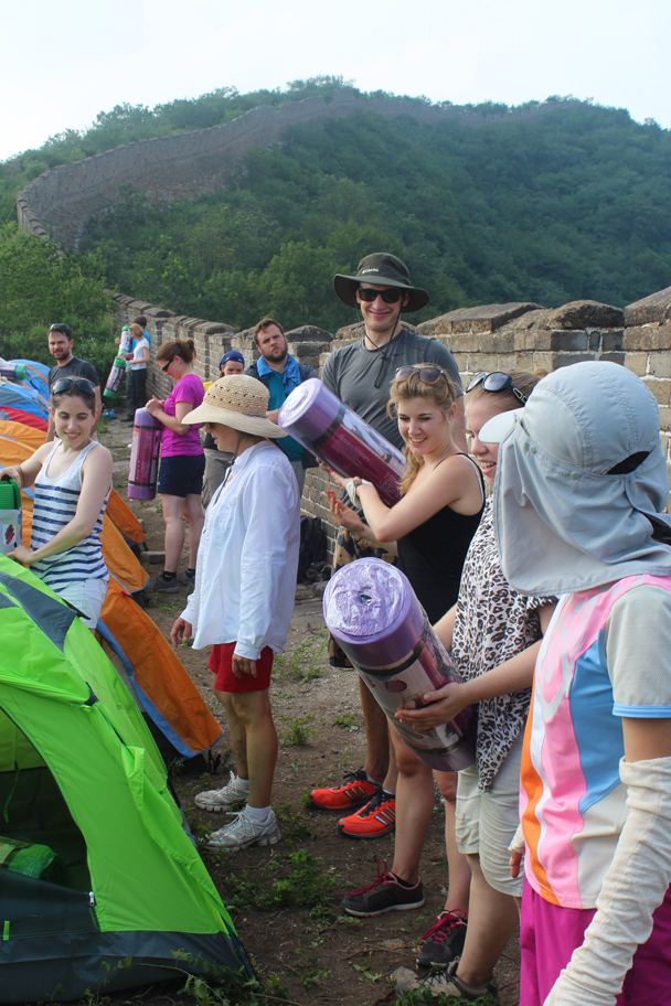 Like a bucket brigade, but with sleeping bags! - Great Wall Spur Camping, July 2014