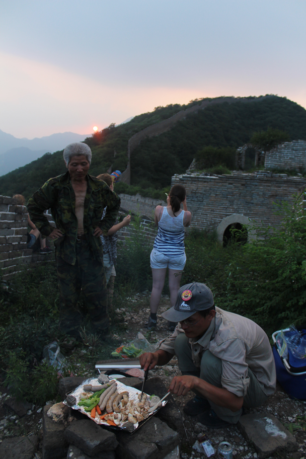 Hongxing cooking sausages, with our local guide looking on - Great Wall Spur Camping, July 2014