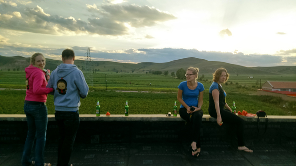 The rooftop of the guesthouse is a great spot to relax with a beer or two - Bashang Grasslands trip, August 2014