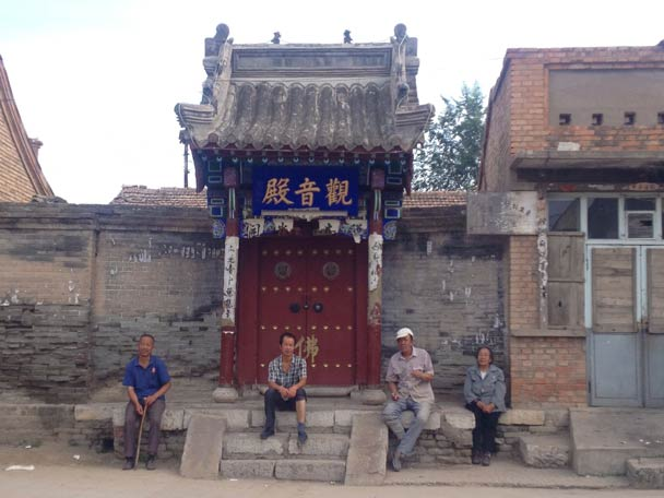Some Nuanquan Town locals sitting streetside - Yu County Overnight Trip 2014/08