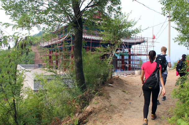 A large gate in the wall is being reconstructed, years after being knocked down to allow a road to go through - Gubeikou Great Wall, 2014/09/06