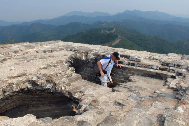 A hiker climbs up for a look, with more of the Gubeikou Great Wall seen in the hills beyond - Gubeikou Great Wall, 2014/09/06